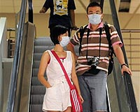 China battles virus spread with masks and disinfectant