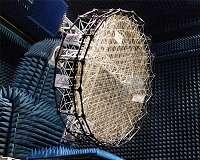 Mesh reflector for shaped radio beams