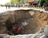 Huge sinkhole swallows bus, kills six in China