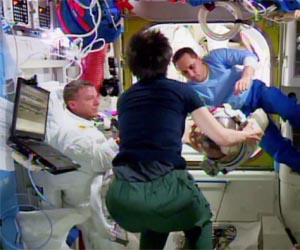 (From left) Spacewalker Terry Virts, Italian astronaut Samantha Cristoforetti and cosmonaut Anton Shkaplerov are in the Quest airlock checking out the spacesuit helmet reported to have a small amount of water in it. Credit: NASA TV